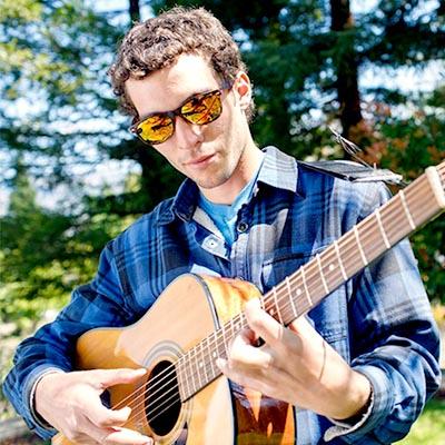 Southern Oregon University Music Student Playing Guitar